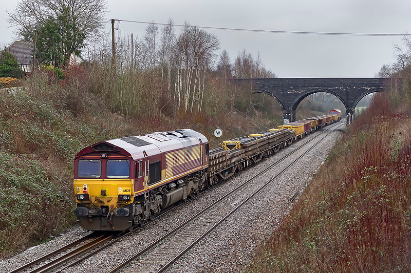 26th Jan 2020:  6W01 from Exeter St Thomas to Westbury is being powered by 66020 and 66129 is now swiched off at the rear.  Pictured from the `Styles Hill  foot bridge in Frome  as it nears Clink Road Junctiuon.  It is actually running nearly 3 1/2 hours early.