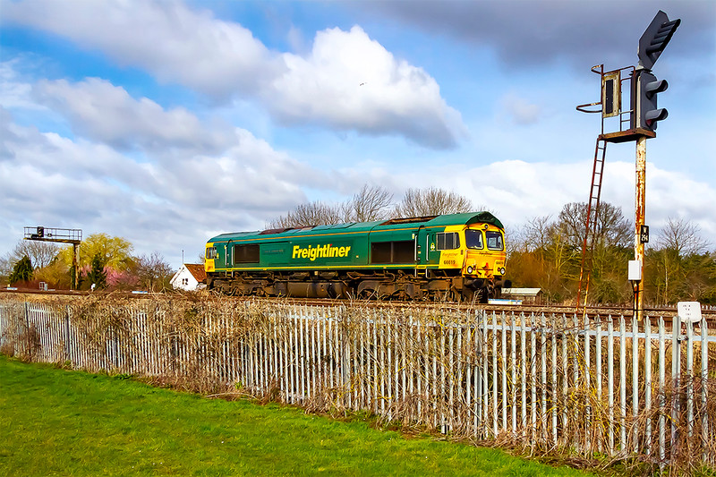 14th Mar 2021:  66619  'Derek W Johnson MBE' is waiting to exit the now closed Westbury Cement Works Sidings.  It is working 0Z10 the first of the day's four trips between these sidings and Frome Station.  Freight Liner are taking over this yard for the storage  of wagons used on the Mendip stone workings.