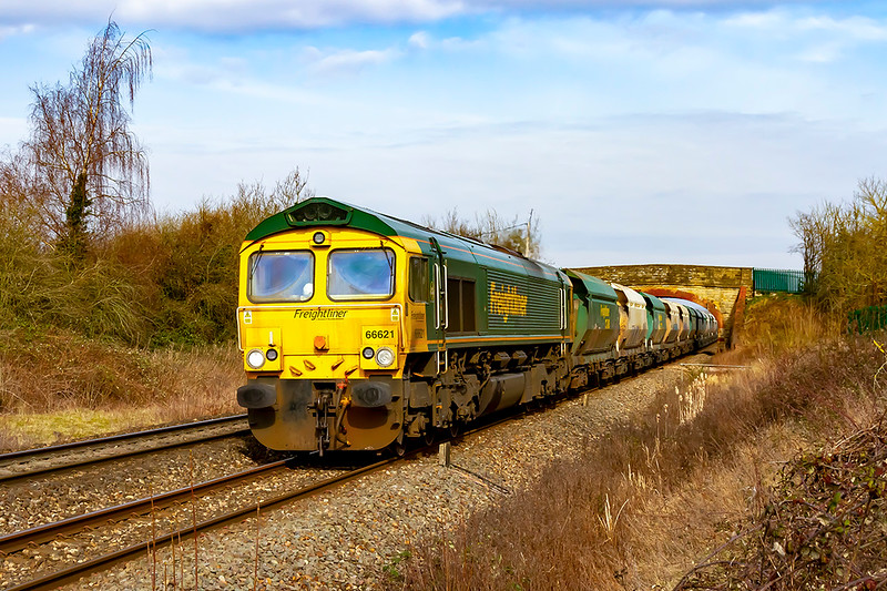 8th Mar 2021:  Passing under the Church Road bridge in Heywood is 66621 slowing down as it will take the East Chord at Hawkeridge Junction to gain access to the Berks & Hants line.  The service is 6A26 fron East Usk T+Yaerd to Hayes Tarmac depot.