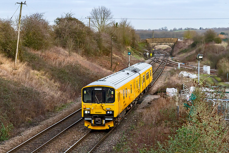 5th Feb 2020:  This used to be a nice view of grass and Hawkeridge signal box but NotworkFail  have  altered all that.  950001 is working to Plymouth Laira from Derby RTC  and will cover the line from Yeovil Pen Ill to Exeter St David via Honiton..