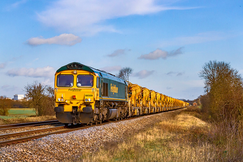 22nd Nov 2020:  6Y15 is the  code that is usually used for workings of the HOBC that is based in Fairwater Yard in Taunton.  The set is pictured at Masters Crossing in Fairwood, just west of Westbury , in the hands of 66509 and 66533 as the train works home from Tackley..