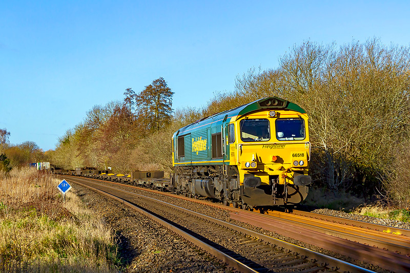 12th Dec 2020:  On a Saturday the Wentloog to Southampton Maritime runs as 4O51 and about three hours earlier than during the week so on a cold but sunny day it was too good to miss. as the sun is in the perfect direction.. Powered by 66518 the service is pictured at the crossing in Sherrington Lane in the Wylye Valley.  Virtually all the train not yet in view was, of course, loaded .