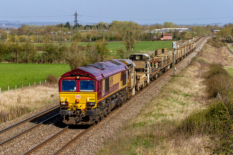 5th Apr 2021:  Nearing it's destibnation at Westbury as it runs through Heywood is 66096 . It has started from Llanwern West Junction at 07.30 and it finally took just under three and a half hours to  get to the Down Yard at Westburuy..
