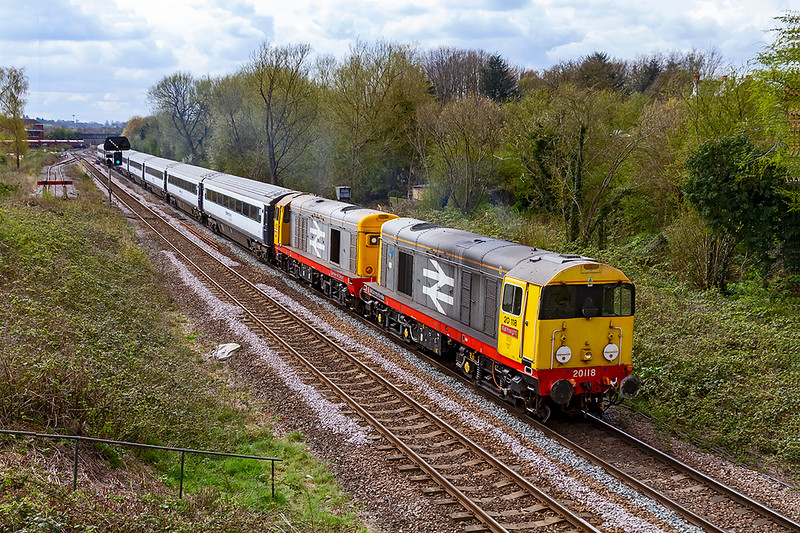 13th Apr 2021:  20118 'Saltburn By The Sea' and 20132 'Barton Hill Depot' are pictured as the leave Wesbury while working 5X20..  Taking 8 ex Chiltern Railway coaches to Long Marston for storage this was planned to lreave Eastleigh TRSMD at  09.56 but was actually 90 minutes late starting and had now lost a further 5 minutes.  It was fortunate the earlier sun was hiding.. because  it would havwe been shinung straight down the line..  It is very good to see something not in God's Worste Railway 'Shite Green'.