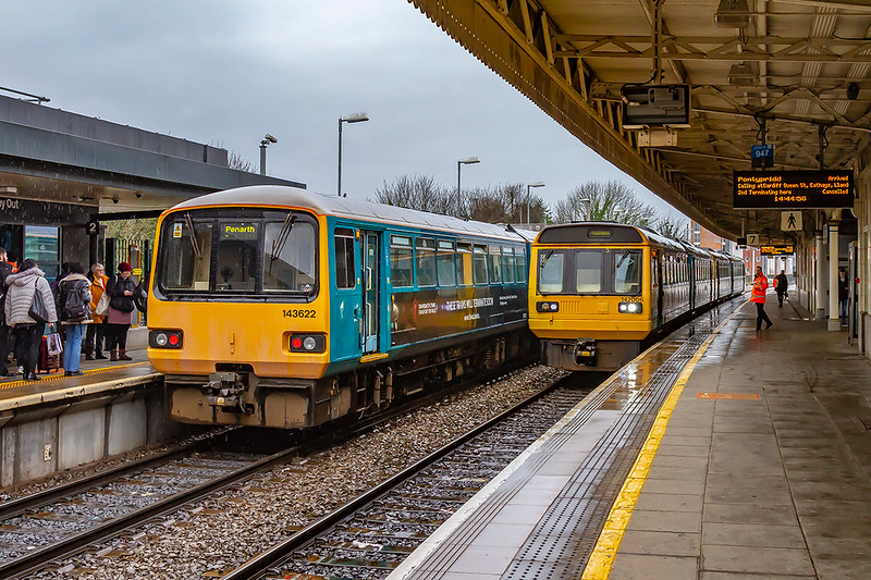19th Feb 2020:  The 'newer'  and the 'older 'pacers pass at Cardo<br /> iff Central.  143622 is  2D48 the 14.33 Penarth to Bargoed and 142006 id2A36 the 13.42 Bridgend Pontypridd