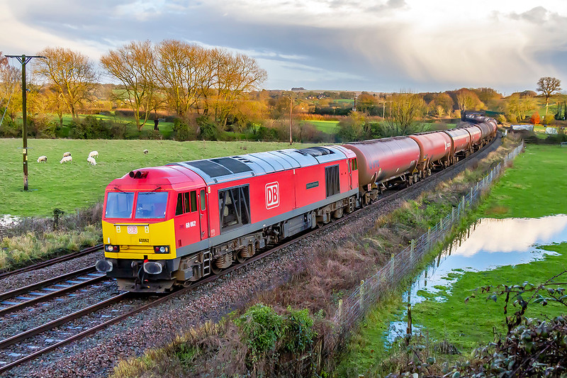 19th Dec 2019:  6B33 is the working that  returns the Murco tanks to Robeston from Theale today powered by 60064 'Stainless Pioneer' is captured ar Great Cheverell.  Prior to thie December 12th Time Table changes this was routed via Reading, Swindon and the Top Road to the Severn Tunnel. but now via the B & H it clears the line for the increased number of IET services to London