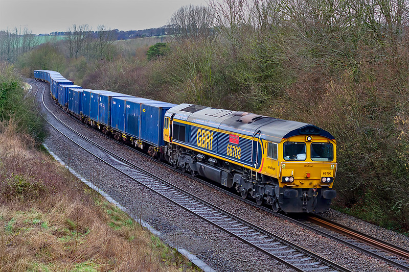 27th Jan 2020:  66703 ' Doncaster PSB 1981-2002,is at the helm of 6Z54 MoD working from Donnington Rft to Marchwood.  This is the first time that I have pictured this working and I do not know when is last ran,r. if ever.  Shame about the weater though.