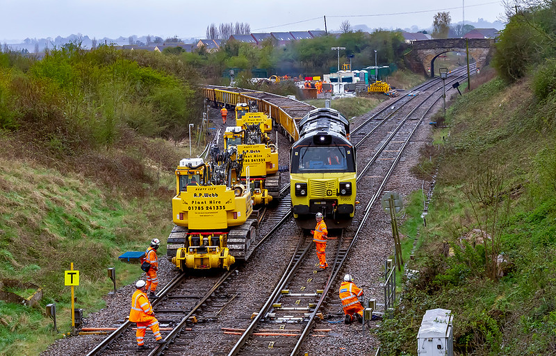 10th Apr 2021:  Pushing the JNAs back into the East Loop at Hawkeridge is 70805.  6C22  is to take the ballast from the other line which is being replaced.  The move is because 6C21 from Bradford Junction is working back to Westbury  on the wrong line..  The High Viz  on the right in the process of changing the point back to the main line route.