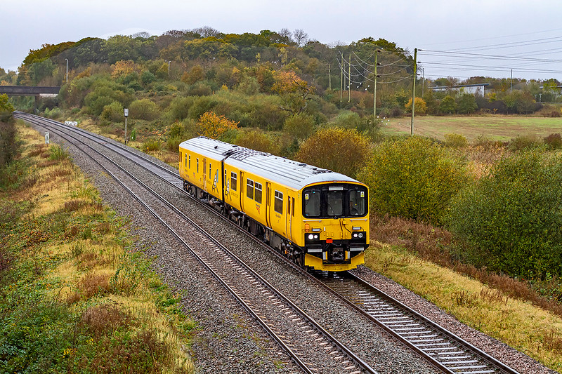 27th Oct 2020?  Almost blending in with the Autumnal clours on a very wet day  at Berkley Marsh is 950001. The Network Rail test unit started from Bristol High Level Siding.and has just completed  trips to  the Merehead and Whatey Quarries.  It is now retracing it's steps to Bristol where it will continue to Plymouth Laira.