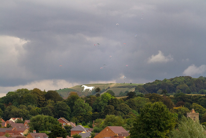5th Oct 13:  The Westbury White Horse and hang gliders pictured from Dilton Marsh Halt