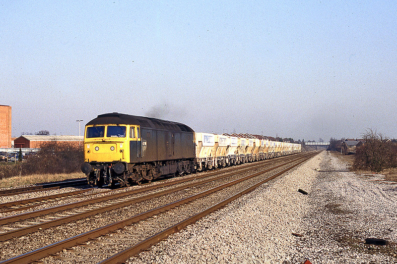 18th Feb 1983:   47196 is passing the Black & Decker factory at White Waltham as it heads west with Yeoman hoppers.  25 years earlier I would have been standing on the Down Main Line at this spot because there was a sidng between the Mains and Reliefs causing the lines to be slewed to the right.