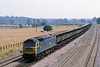 29th Jul 81:  47103 westbound with empty coal hoppers through Lower Basildon