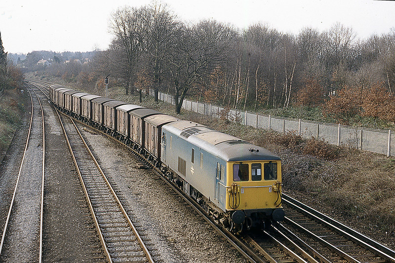 8th Feb 1983:  73125 backing the Eastleigh Vans into the spur on the Guildford line