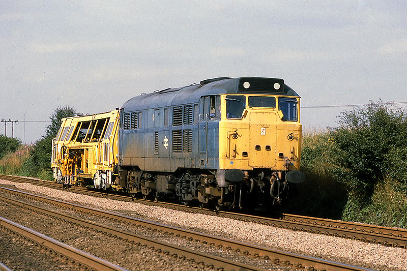 10th Aug 81:  Trundling south through Langford are 31402 and a Tamper