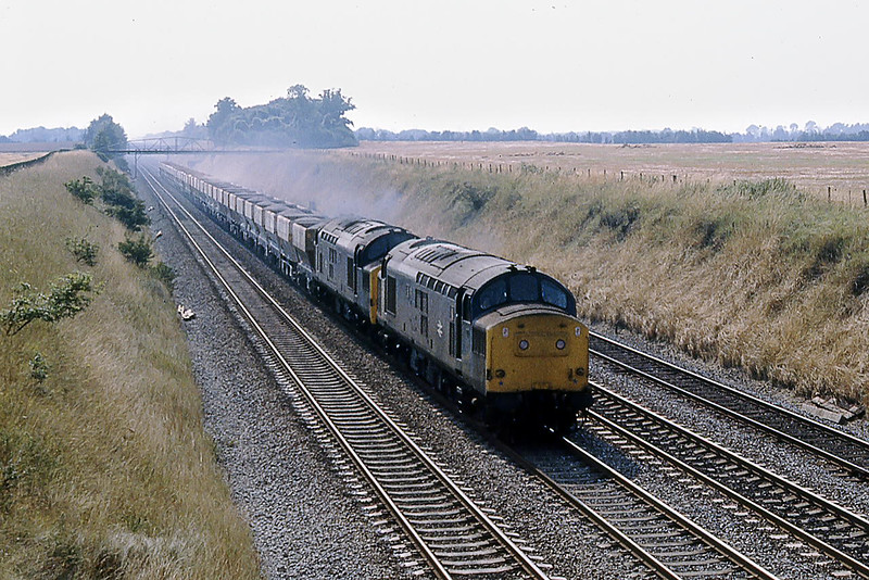 12th Aug 1981:  37224 & 37157 on the Up Main at Shottesbrooke with stone from Merehead