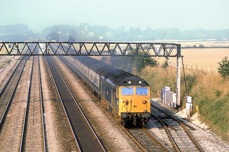 12th Aug 1981:  50001 Dreadnought works the 06.42 from Westbury up the Relief past Milley Bridge towards Paddington