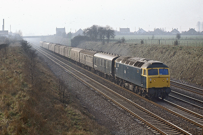 19th Feb 1983:  47249 with one of the regular services of empty Newspaper vans from the West of England and South Wales captured from Breadcroft Lane in White Waltham