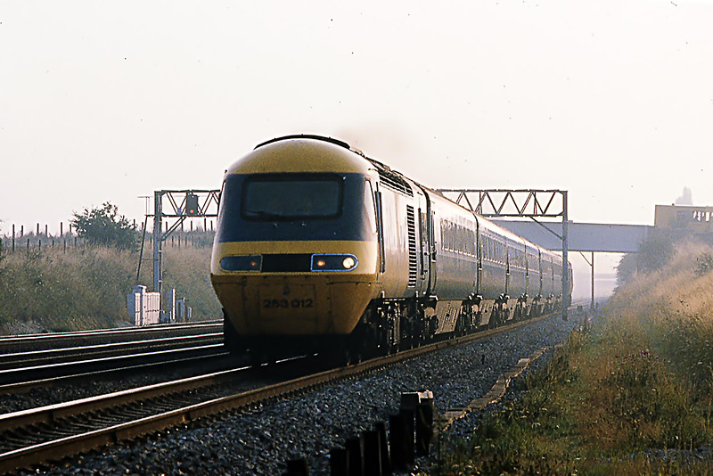 12th Aug 1981:  At 7.38am 253012 races under Milley Bridge in Waltham St Lawrence  with the 07.20 from Paddington to Paignton.  At this tiem trains were allowed 22 minutes for the 36 miles between Paddington and Reading.