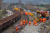 24th Dec 2018:  Looking towars Hawkeridge on the right the Colas crane is. delivering the first length of new track.  On the left are sections, including pointwork.