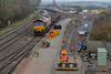 24th Dec 2018:  66053 stands with fresh ballast as the remote controlled tamper flattens the base layer out.
