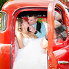 Bride and Groom kissing in old truck
