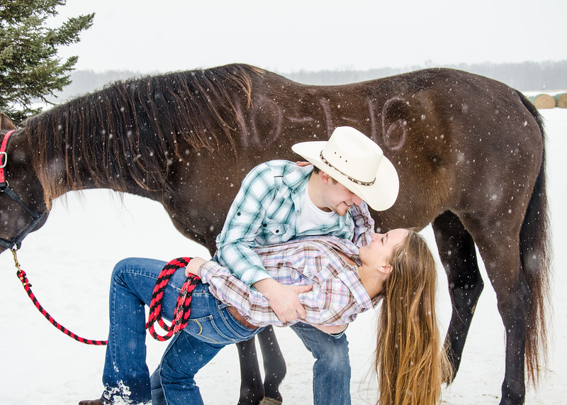 kissing in front of the horse engagement session