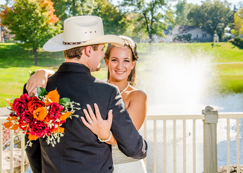 cowboy and his bride with bouquet