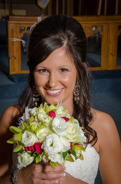 Smiling bride with flowers