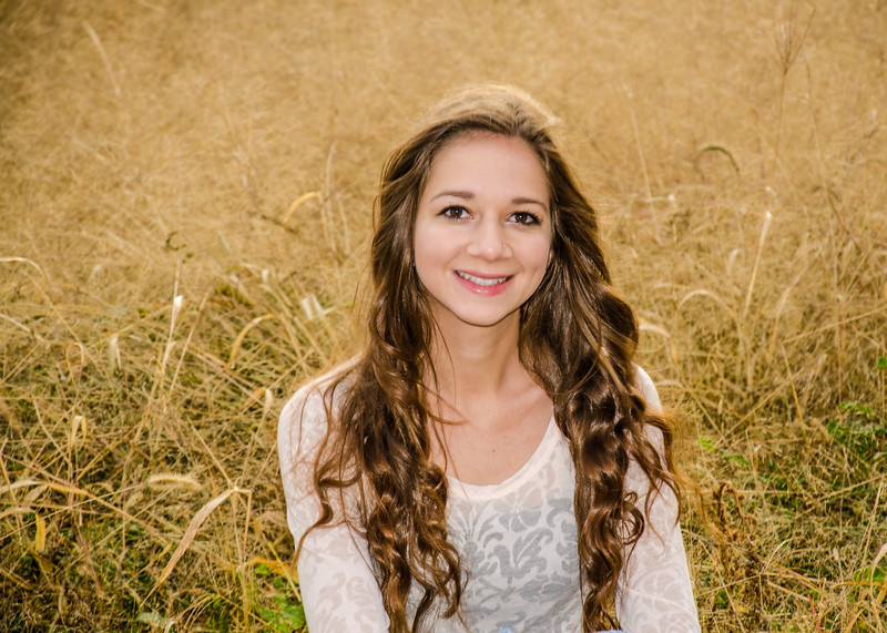 senior girl portrait in long grass