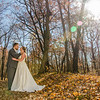 bride and groom in the fall leaves
