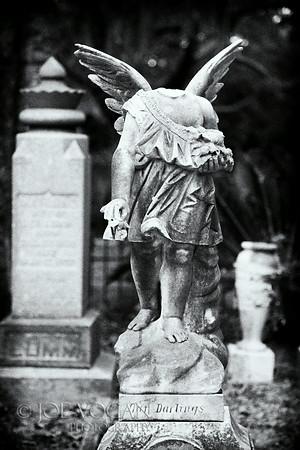 Angel with vandalized head, Bosque Bello Cemetery, Fernandina Beach, Florida
