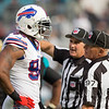 Mario Williams negotiates with a referee. Buffalo Bills vs. Jacksonville Jaguars, December 15th, 2013 (Everbank Field, Jacksonville, Florida)