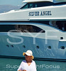 Lady with superyacht