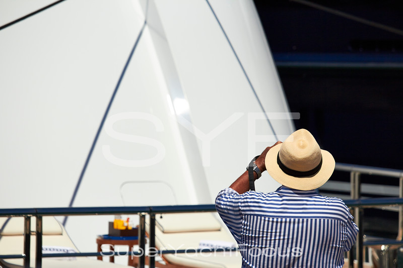 Tourist photographing yacht