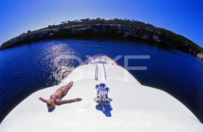 Girl sunbathing on motoryacht