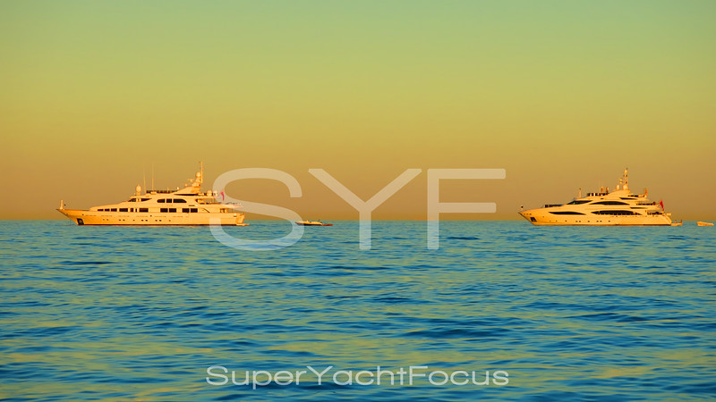 superyachts at sunset
