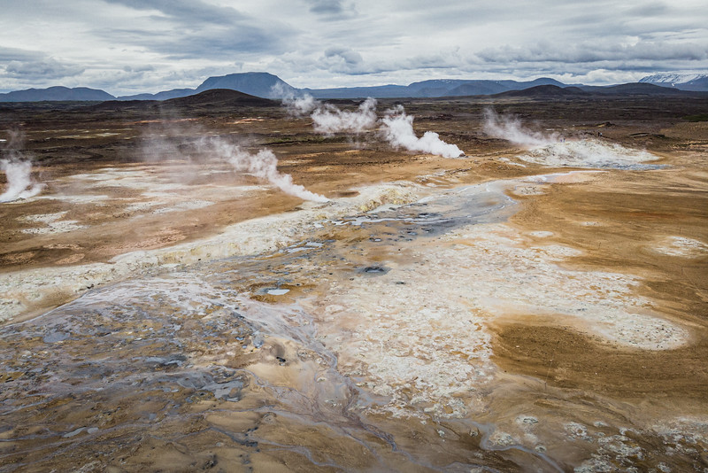 One of the largest geothermal field in Iceland, Námafjall/Hverir. The area is covered with smoking fumaroles and boiling mud pots, surrounded by sulphur crystals of many different colours.