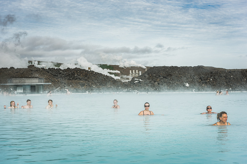 The Blue Lagoon, one of Iceland's most important tourist attractions. Geothermal water that has already generated electricity at the Svartsengi Power Station and has passed through a heat exchanger to provide heat for a municipal water heating system is finally  fed into the lagoon. The water's high silica content keeps it from leaching into the lava field and gives it an appealing aqua tint.