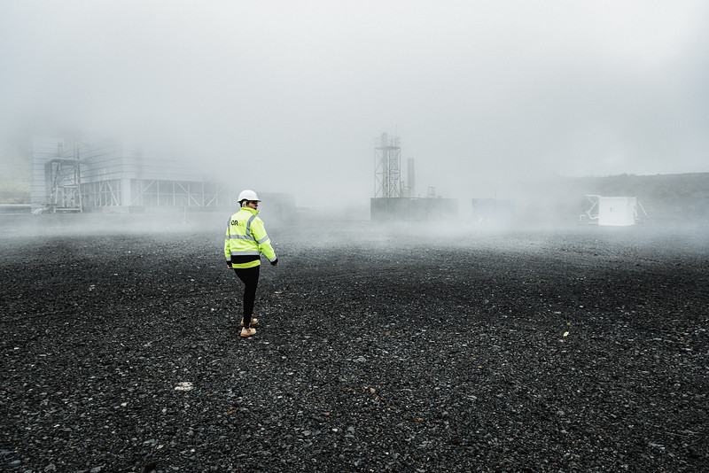 An operator in Hellisheiði Power Station in Hengill, Iceland 's largest geothermal plant and the world's third largest. The power station is a flash steam combined heat and power plant generating 303MW of electricity and 400MW of thermal energy. Approximately 87% of hot water for households and for heating in Iceland comes from geothermal energy. Between 1990 and 2014, Iceland's geothermal electricity production increased 1,700%