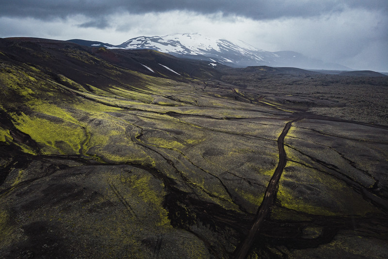 A lava field on the slopes of Mount Hekla, in the highly active volcanic zone along the south shore. Hekla is the most active volcano in Iceland. The area around Hekla was once forested, but the combined effect of human habitation and the volcanic activity has left an unstable surface very susceptible to erosion. The Hekluskógar reforestation project plans to restore the previously present birch and willow woodland to the slopes of the mountain.