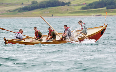 The finals of St Ayles Skiff World Championships get underway at Ullapool, the  team from Galgael, Glasgow Schools negotiate the turn.  Picture: Paul Campbell