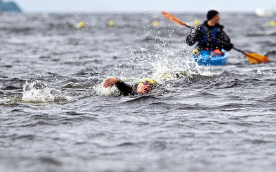 Monster Swim 2013, Loch Ness. Swimmers cover a distance of 1 or a 1/2 mile circuit from the shore at Dores.  A competitor battles through the waves as the conditions worsen.  Picture: Paul Campbell  Tel: 07790 299920