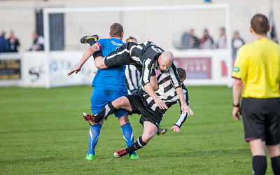 Flying high:  Wick's Gary Weir get tangled jumping for the ball. Picture: Paul Campbell