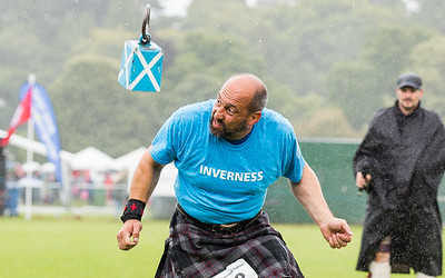 It's behind you: A competitor moves out of the way as the Weight Over the Bar comes down at the Inverness Highland Games.   Picture: Paul Campbell.