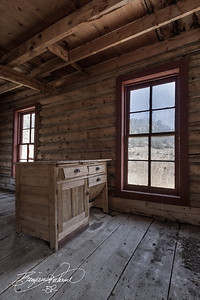 3 image blend.  This cabin was built in the 1860s.  The old flour desk was in really good shape.  I decided to do this photo with minimal color.  Time seemed to be fading away, so I felt it was symbolic.  -BP-