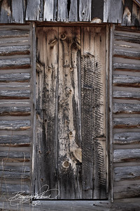 This cabin was built in the 1860s.  I decided to do this photo with minimal color.  Time seemed to be fading away, so I felt it was symbolic.  -BP-