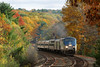"With the Fall colors peaking here in central Massachusetts, Amtrak 449 negotiates the ""S"" curves at MP60, Spencer, MA on the CSX Boston Line. 10/18/2013 - 598C8946dK"