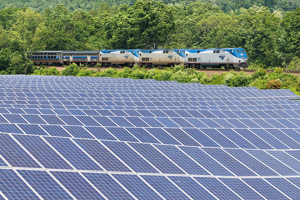 """""""And if you look to your right, you will see the future..."""" Train 449 passes an array of 4484 PV (photovoltaic) panels on 5 acres of land at MP80, Palmer, MA. This solar farm should produce enough electricity for about 130 homes. 6/22/2013 - 598C0989dK"""