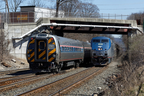 Amtrak 449, with a rather shabby looking engine #108 on the nose, passes the Vermonter at MP83, Palmer, MA. It's unusual that the Vermonter will head west with a control car in the lead rather than the usual push/pull engine configuration. 4/17/2013 - 598C9015dK