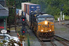 CSX train Q022 rolls over the diamond and past the historic depot at MP83 in Palmer, MA. 8/28/2013 - 598C6563dK